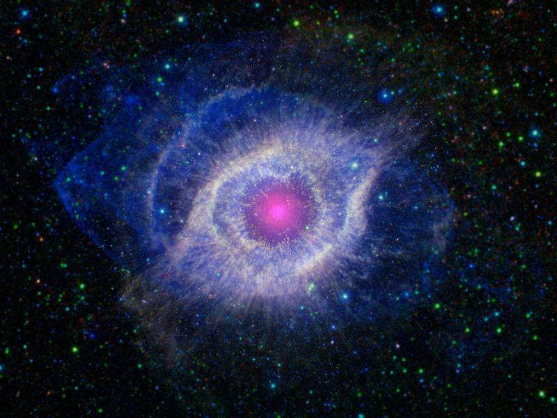eye-shaped nebula with pink center in a star field