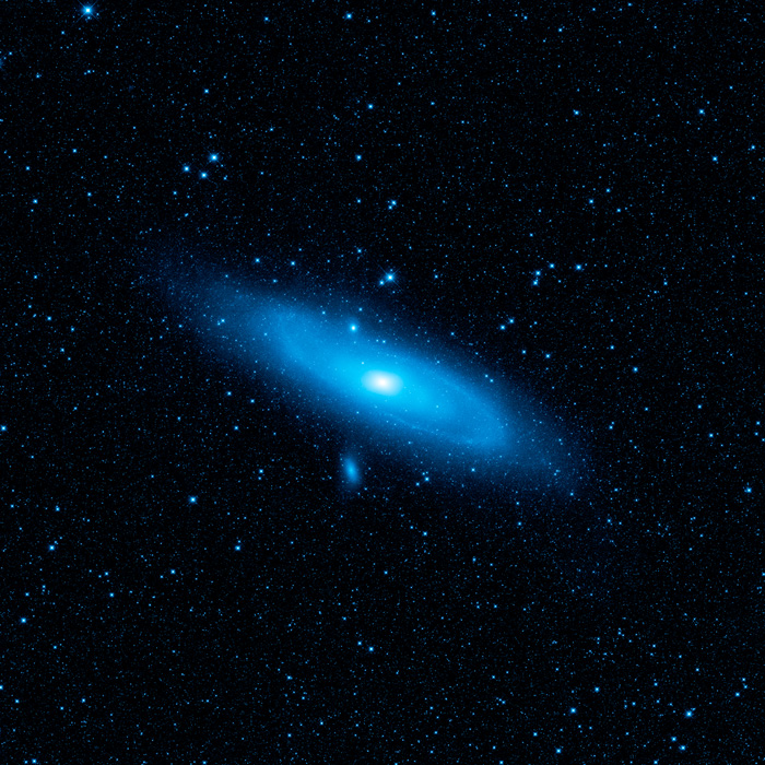 This image shows the Andromeda Galaxy as seen through a shorter-wavelength camera. The older stellar population appear in blue