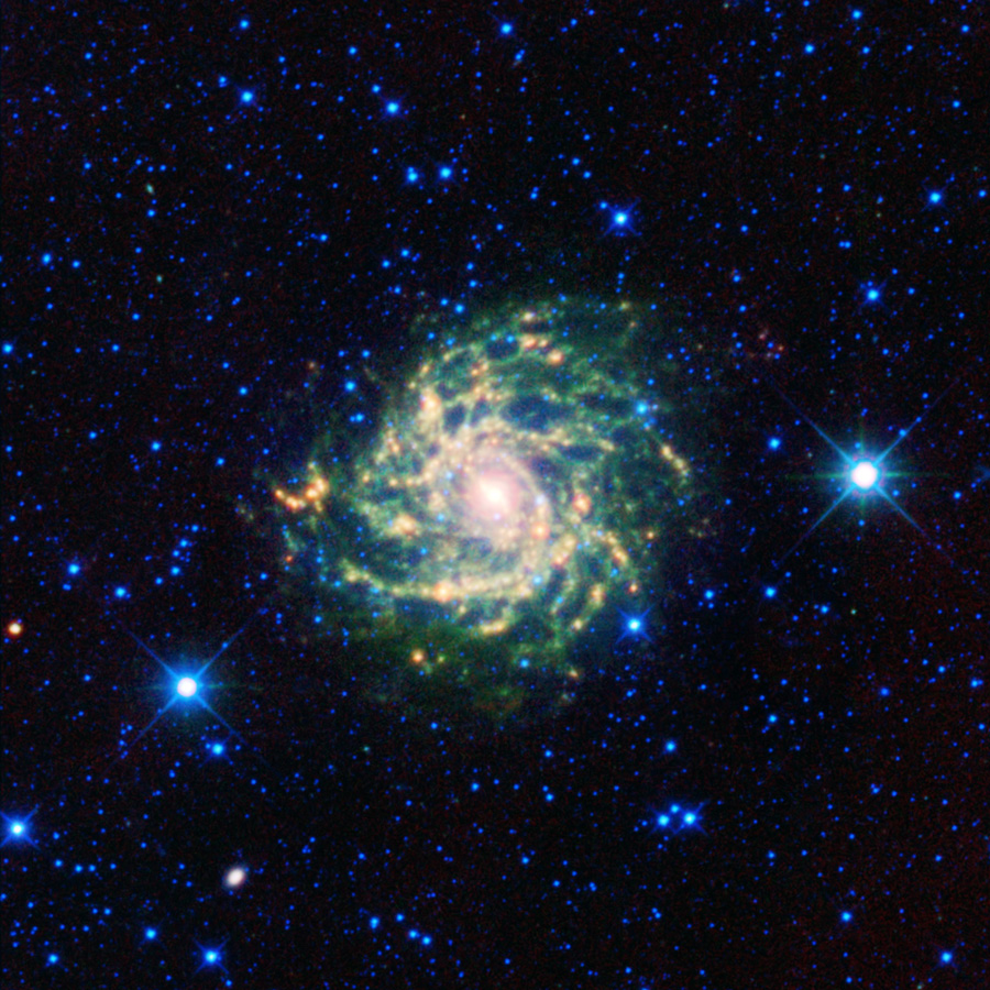 This pinwheel of stars, dust and gas, which make up IC 342, is similar in size to our own Milky Way Galaxy (one-hundred thousand light-years across).