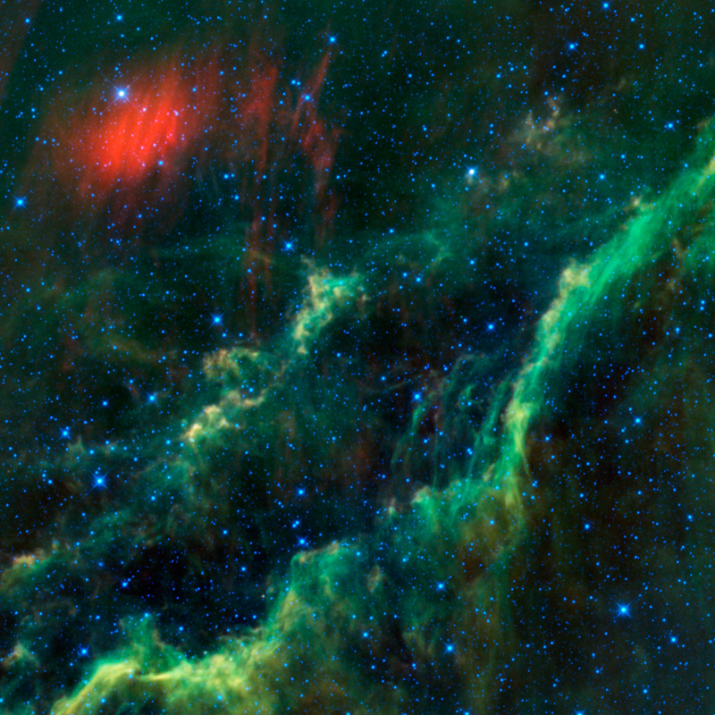A bright star, known as Menkhib, is in the upper left hand corner near a red dust cloud.  A star forming cloud, known as the California Nebula runs diagonally through the image.