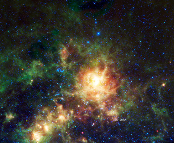 The large multicolored cloud in the center is an irregular dwarf galaxy that orbits the Milky Way.