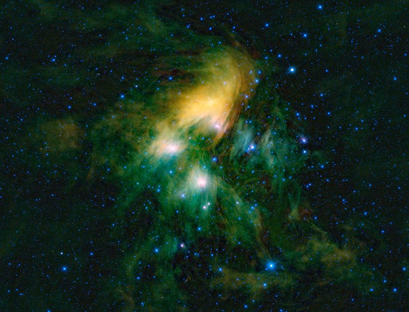 In this infrared view of the Pleiades from WISE, the cluster is seen surrounded by an immense green looking cloud of dust.