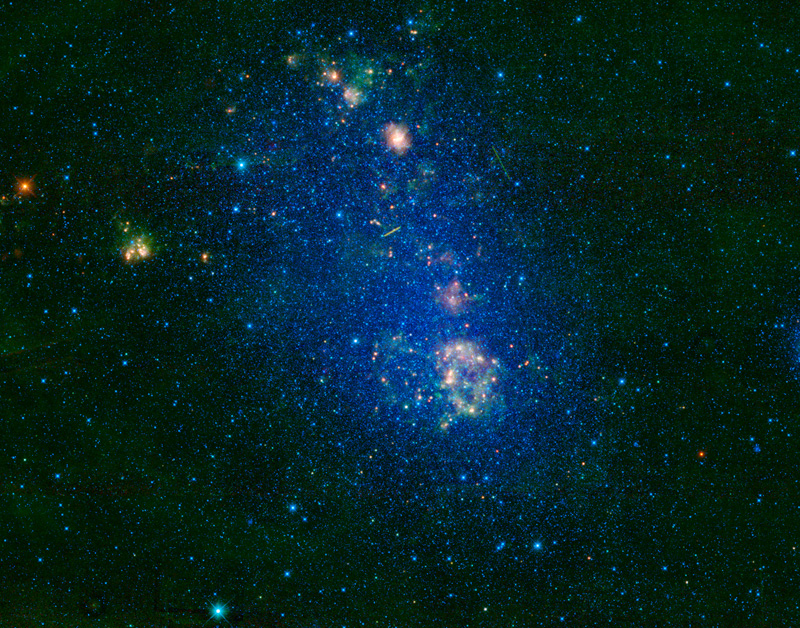 The Small Magellanic Cloud located in the constellation Tucana is an irregularly shaped galaxy.  The two streaks seen in the upper half of the image are satellites orbiting Earth.
