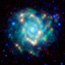 A glowing blue/white pinwheel-shaped galaxy in a field of stars.