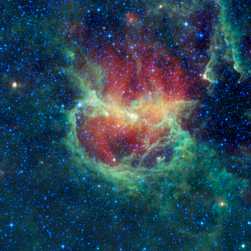 The multicolored clouds in the field of stars makeup the Lambda Centauri Nebula.