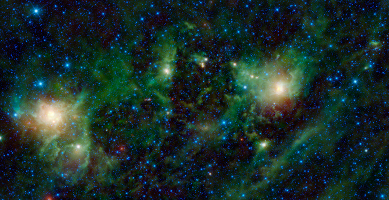 A field of blue and cyan stars, with red and green wispy nebula at center.
