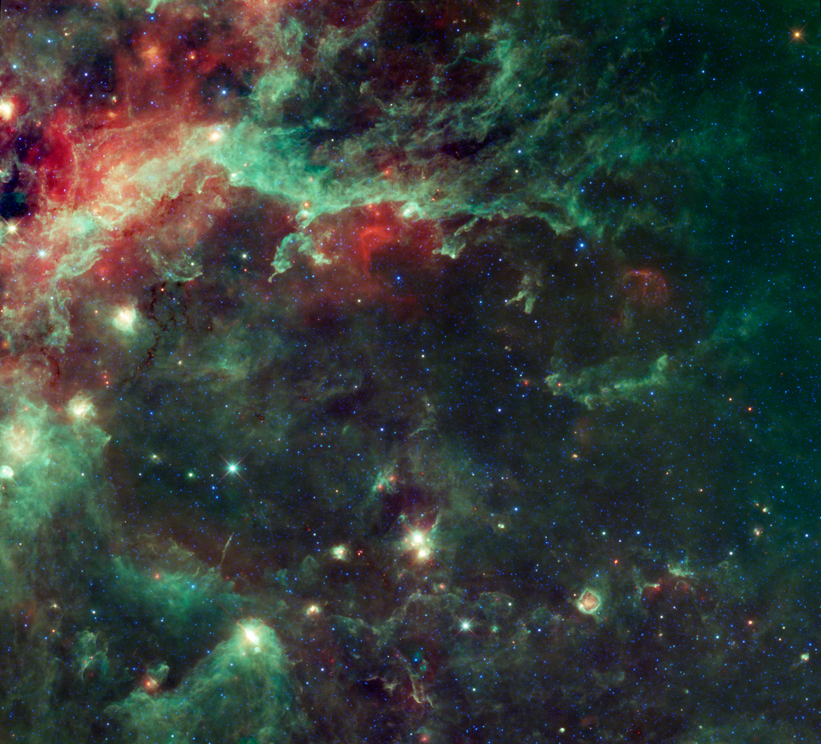The multicolored clouds make up the large complex of star forming clouds and stellar clusters found in the constellation Cygnus.