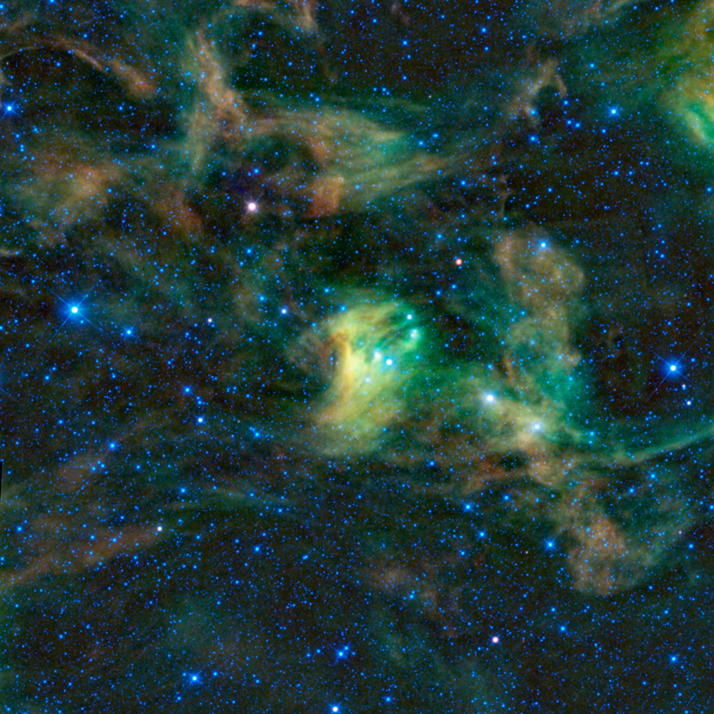 A black sky light with hundreds of blue stars and wisps of interstellar dust