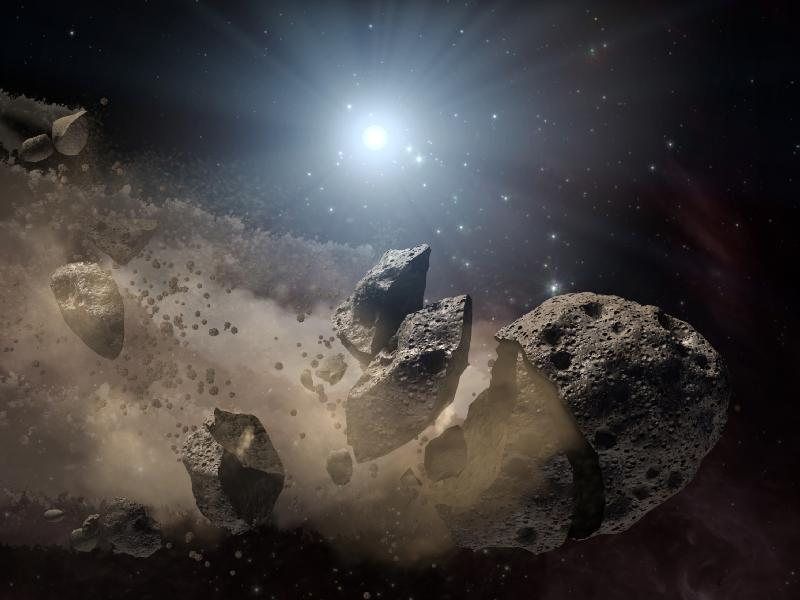 This artist's concept shows a broken-up asteroid.