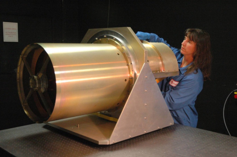 Image of a scientist working on the WISE Telescope.